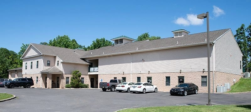 Exterior of building and parking lot of Silver Linings Recovery Center
